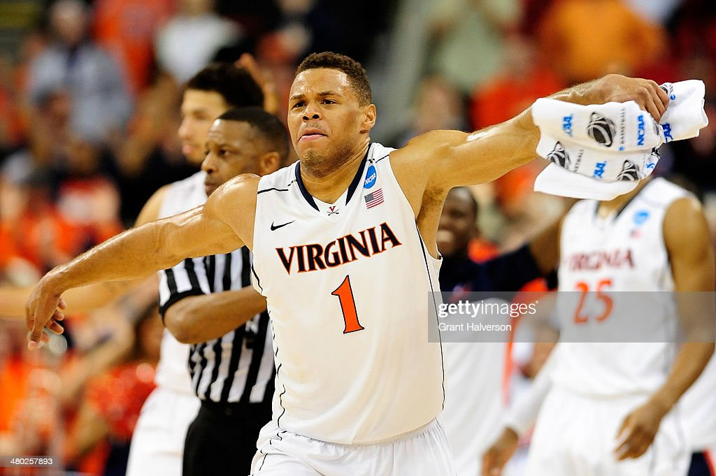 Justin Anderson #1 of the Virginia Cavaliers celebrates late in the game against the Memphis Tigers during the third round of the 2014 NCAA Men's Basketball Tournament at PNC Arena on March 23, 2014 in Raleigh, North Carolina.