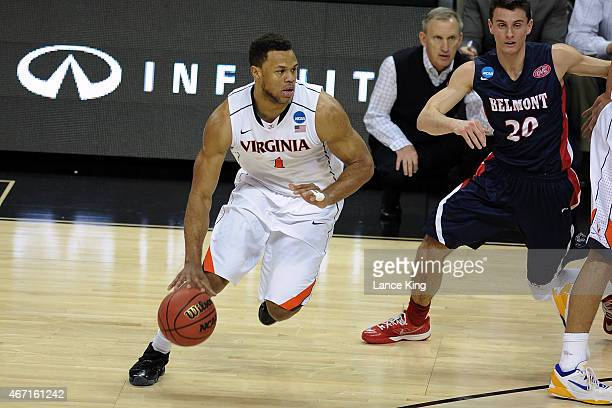 Justin Anderson of the Virginia Cavaliers dribbles against the Belmont Bruins during the second round of the 2015 NCAA Men's Basketball Tournament at...