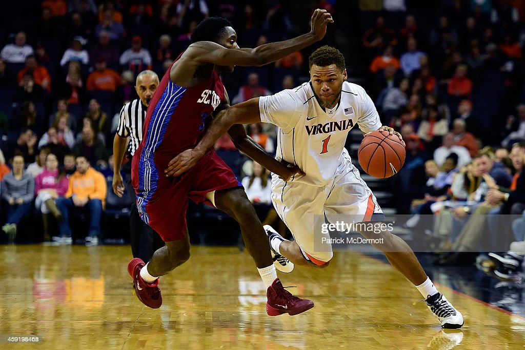 Justin Anderson #1 of the Virginia Cavaliers drives against against Greg Mortimer #3 of the South Carolina State Bulldogs during the first half of a game at John Paul Jones Arena on November 18, 2014 in Charlottesville, Virginia.