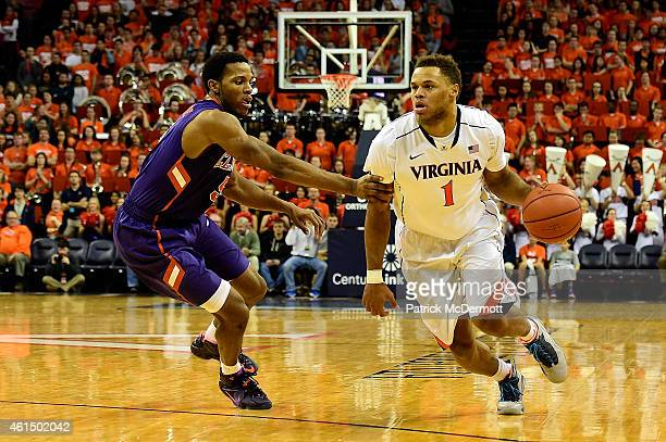 Justin Anderson of the Virginia Cavaliers drives to the basket against Jaron Blossomgame of the Clemson Tigers in the second half during a basketball...