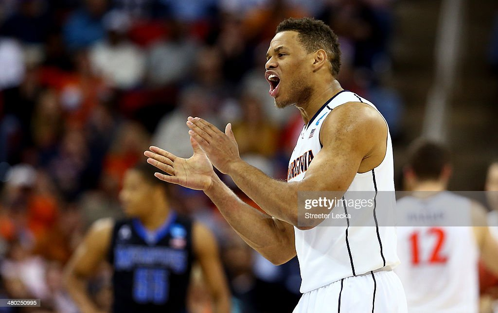 <a gi-track='captionPersonalityLinkClicked' href=/galleries/search?phrase=Justin+Anderson+-+Basketballer&family=editorial&specificpeople=13887915 ng-click='$event.stopPropagation()'>Justin Anderson</a> #1 of the Virginia Cavaliers reacts after a play in the first half against the Memphis Tigers during the third round of the 2014 NCAA Men's Basketball Tournament at PNC Arena on March 23, 2014 in Raleigh, North Carolina.
