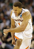 Justin Anderson of the Virginia Cavaliers reacts against the Belmont Bruins during the second round of the 2015 NCAA Men's Basketball Tournament at...