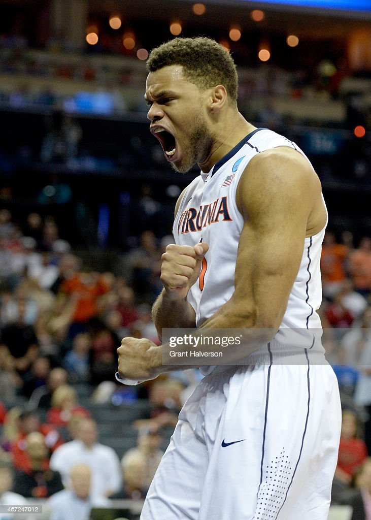 Justin Anderson #1 of the Virginia Cavaliers reacts against the Michigan State Spartans during the third round of the 2015 NCAA Men's Basketball Tournament at Time Warner Cable Arena on March 22, 2015 in Charlotte, North Carolina.