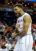 Justin Anderson of the Virginia Cavaliers reacts against the Michigan State Spartans during the third round of the 2015 NCAA Men's Basketball...