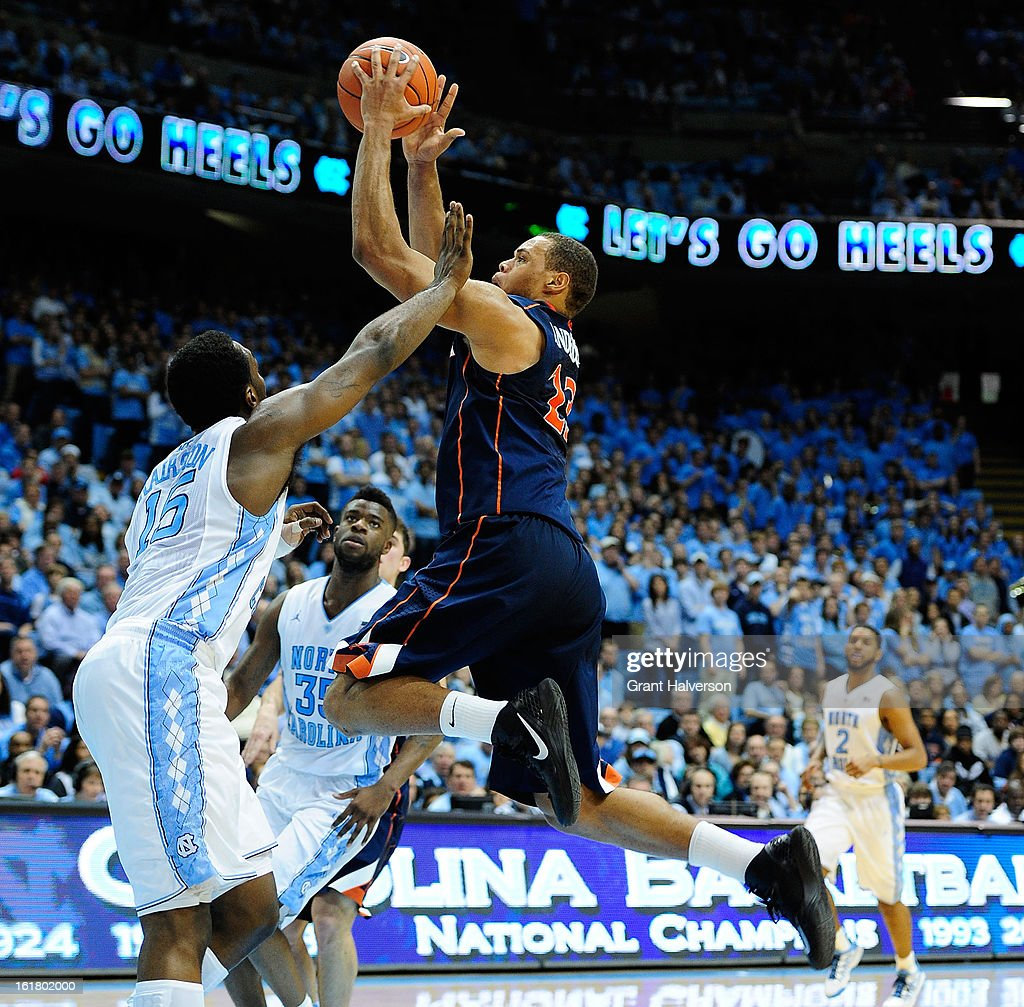 Justin Anderson #23 of the Virginia Cavaliers shoots over P.J. Hairston #15 of the North Carolina Tar Heels during play at the Dean Smith Center on February 16, 2013 in Chapel Hill, North Carolina. North Carolina won 93-81.