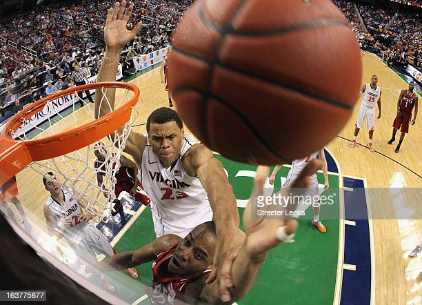 Justin Anderson of the Virginia Cavaliers tries to block Lorenzo Brown of the North Carolina State Wolfpack during the quarterfinals of the Men's ACC...