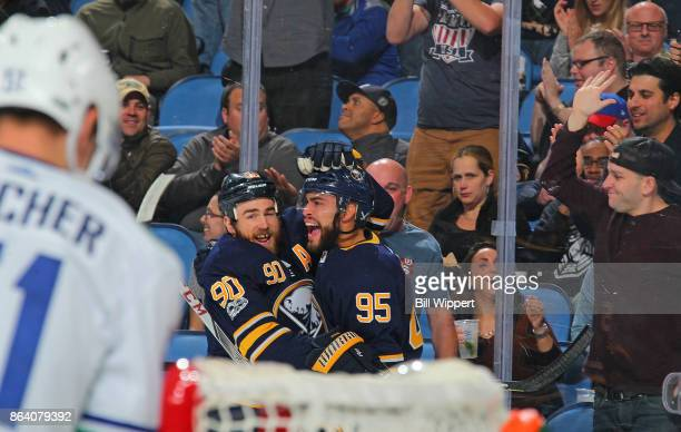 Justin Bailey of the Buffalo Sabres celebrates his first period goal against the Vancouver Canucks with Ryan O'Reilly during an NHL game on October...