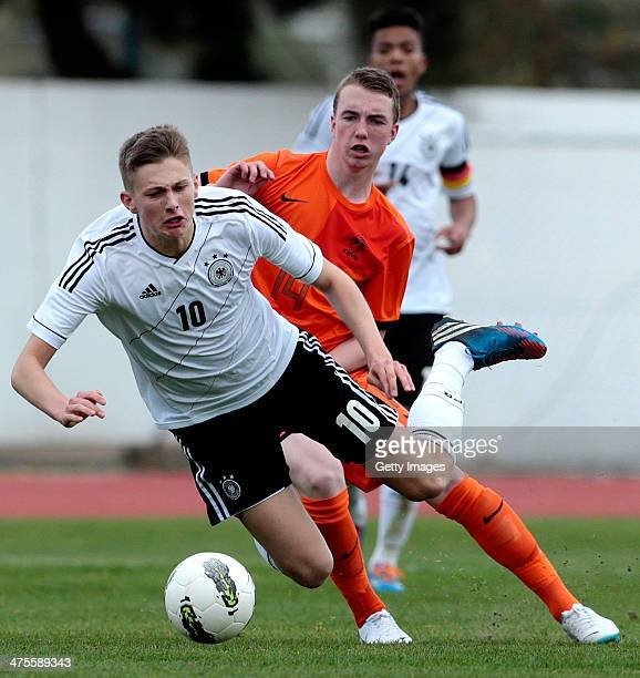 justin bakker of Netherlands challenges ole kauper of Germany during the Under17 Algarve Cup between U17 Netherlands and U17 Germany at Albufeira...