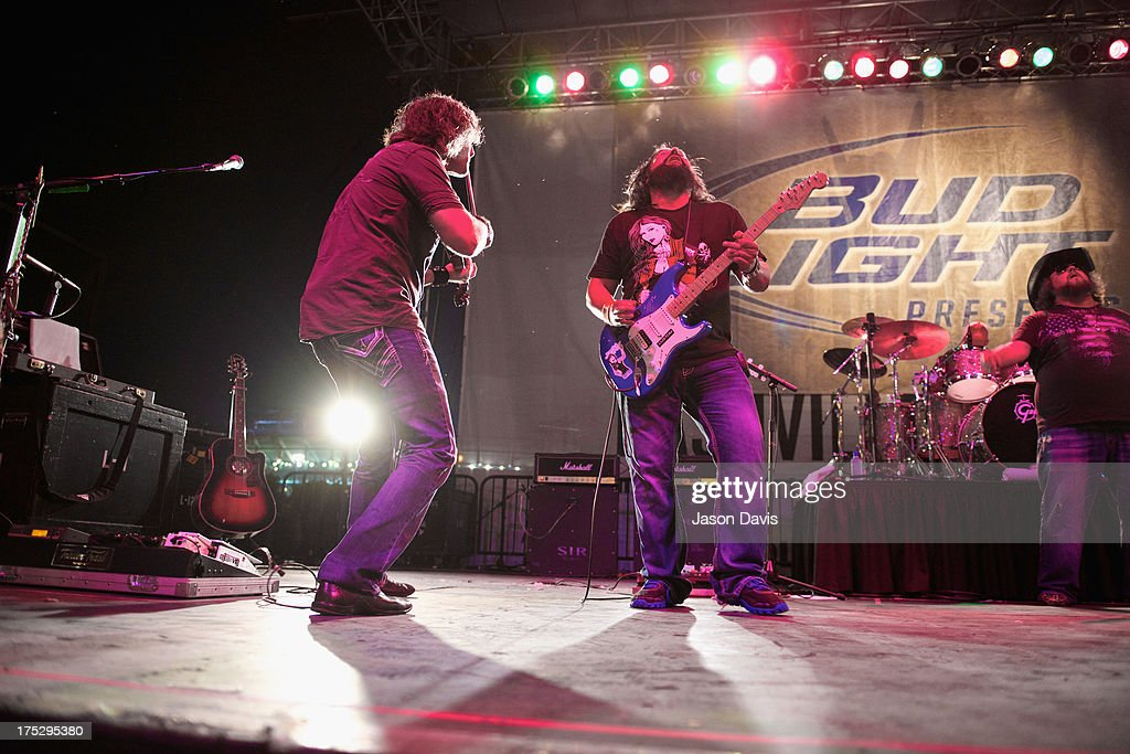 Justin Bertoldie and Brad Henderson of the Colt Ford Band perform during Bud Light Music First 50/50/1 on August 1, 2013 in Nashville, Tennessee.