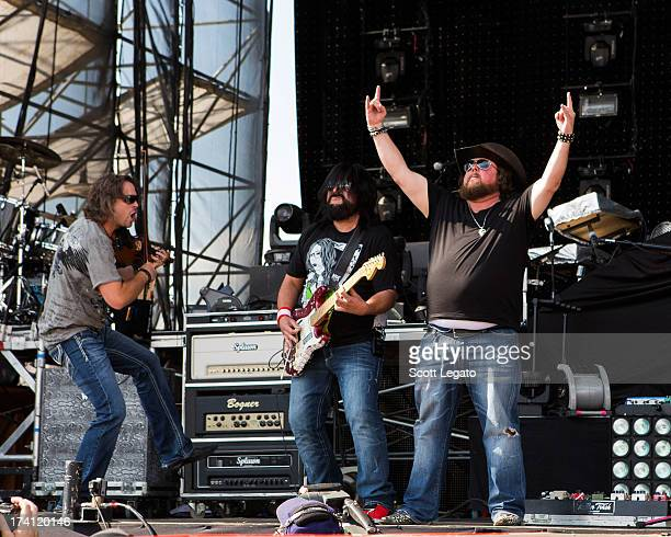 Justin Bertoldie Brad Henderson and Colt Fod of the Colt Ford band performs during the 2013 Faster Horses Festival on July 20 2013 in Brooklyn...