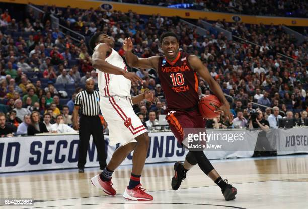 Justin Bibbs of the Virginia Tech Hokies drives against Khalil Iverson of the Wisconsin Badgers in the first half during the first round of the 2017...