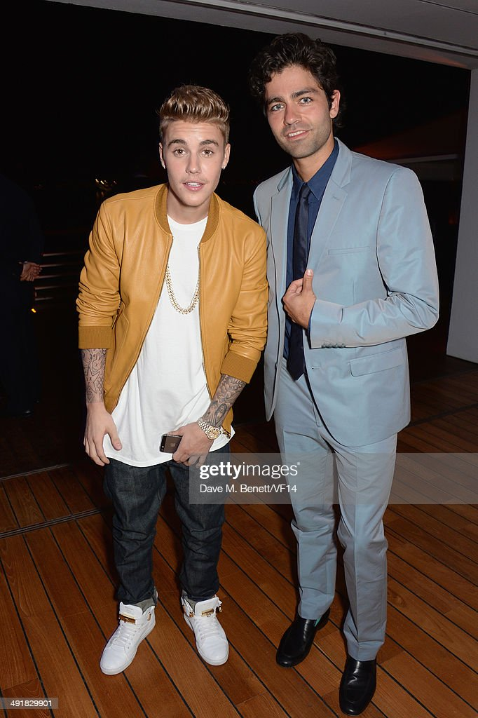 Justin Bieber and Adrian Grenier attend the Vanity Fair And Armani Party at the 67th Annual Cannes Film Festival on May 17, 2014 in Cap d'Antibes, France.