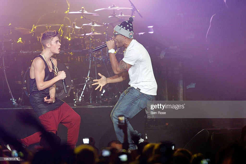 Justin Bieber and Ludacris perform onstage during Power 96.1's Jingle Ball 2012 at the Philips Arena on December 12, 2012 in Atlanta.