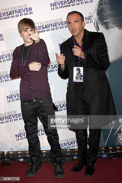 Justin Bieber and Nikos Aliagas attend the 'Justin Bieber Never Say Never' Premiere at Le Grand Rex on February 17 2011 in Paris France