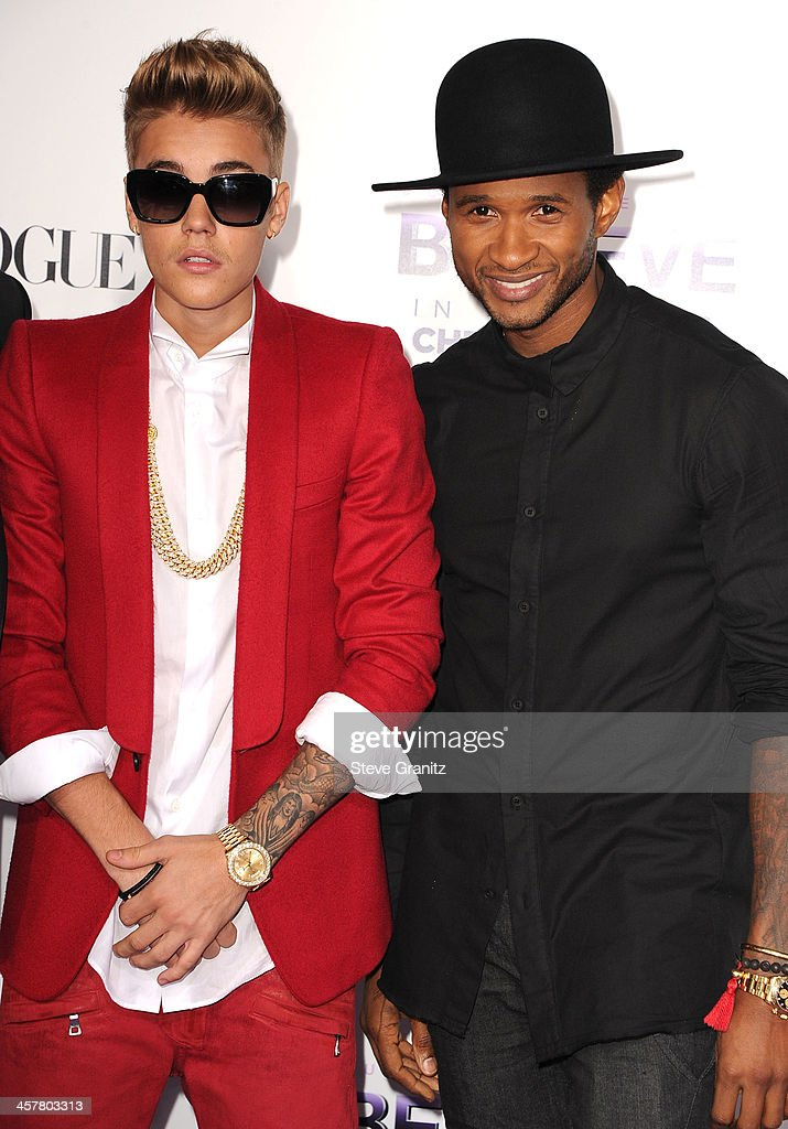 Justin Bieber and Usher arrives at the 'Justin Bieber's Believe' World Premiere at Regal Cinemas L.A. Live on December 18, 2013 in Los Angeles, California.