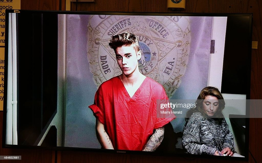 <a gi-track='captionPersonalityLinkClicked' href=/galleries/search?phrase=Justin+Bieber&family=editorial&specificpeople=5780923 ng-click='$event.stopPropagation()'>Justin Bieber</a> appeared briefly in front of Judge Joseph Farina, via video, clad in red jail-issued scrubs at Miami-Dade Circuit Court in Florida, Ja. 23, 2014. Bond was set at $2,500.
