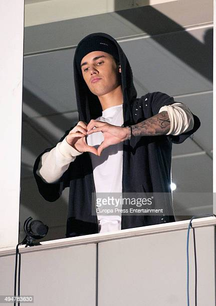 Justin Bieber appears on a balcony to wave to fans gathered outside Vertice Studio during 'El Hormiguero' Tv Show on October 28 2015 in Madrid Spain