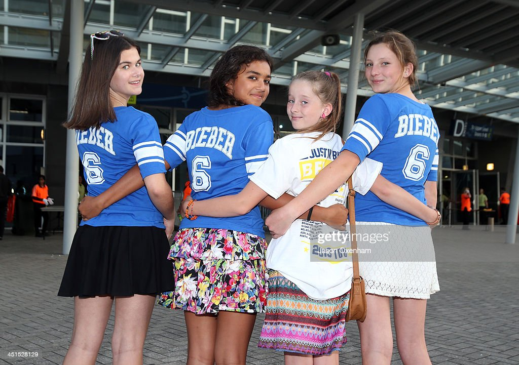 Justin Bieber concert goers (from left) Astrid Poll, Joel Kingi, Lily Llewelyn and Ella Hurdley (all 12) arrive at Vector Arena on November 23, 2013 in Auckland, New Zealand.
