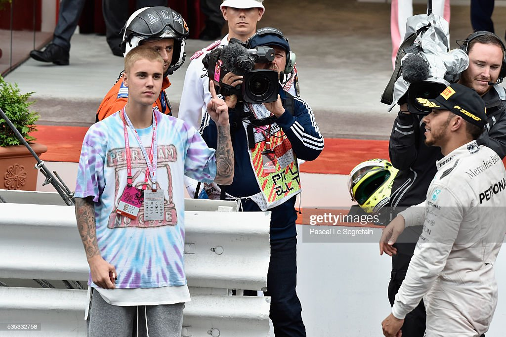 <a gi-track='captionPersonalityLinkClicked' href=/galleries/search?phrase=Justin+Bieber&family=editorial&specificpeople=5780923 ng-click='$event.stopPropagation()'>Justin Bieber</a> congratulates F1 Grand Prix of Monaco winner <a gi-track='captionPersonalityLinkClicked' href=/galleries/search?phrase=Lewis+Hamilton+-+Racecar+Driver&family=editorial&specificpeople=586983 ng-click='$event.stopPropagation()'>Lewis Hamilton</a> of Great Britain during the podium ceremony on May 29, 2016 in Monte-Carlo, Monaco.