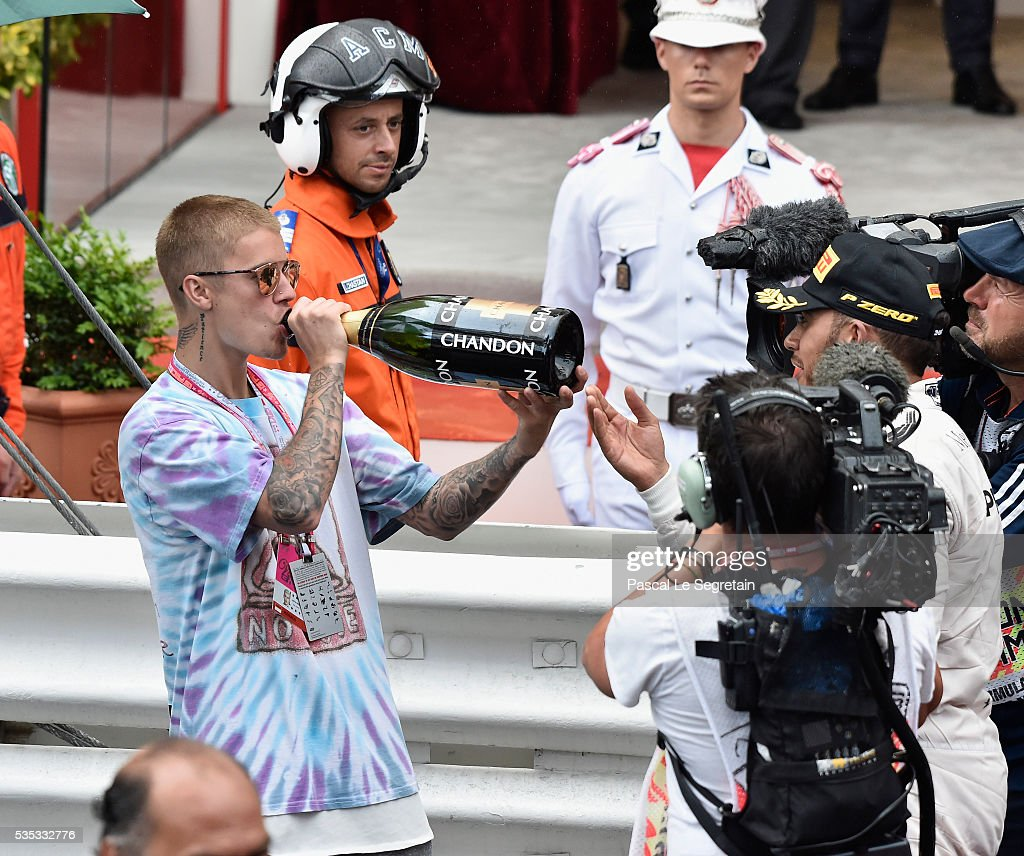 <a gi-track='captionPersonalityLinkClicked' href=/galleries/search?phrase=Justin+Bieber&family=editorial&specificpeople=5780923 ng-click='$event.stopPropagation()'>Justin Bieber</a> drinks champagne from the bottle of F1 Grand Prix of Monaco winner, <a gi-track='captionPersonalityLinkClicked' href=/galleries/search?phrase=Lewis+Hamilton+-+Racecar+Driver&family=editorial&specificpeople=586983 ng-click='$event.stopPropagation()'>Lewis Hamilton</a> of Great Britain during the podium ceremony on May 29, 2016 in Monte-Carlo, Monaco.
