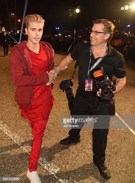 Justin Bieber greets photographer Kevin Mazur at the MTV EMA's 2015 at the Mediolanum Forum on October 25 2015 in Milan Italy