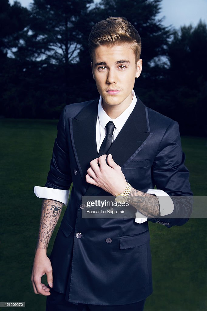 Justin Bieber is photographed at AmfAR's 21st Cinema Against AIDS Gala for AmfAR on May 22, 2014 in Cap d'Antibes, France.