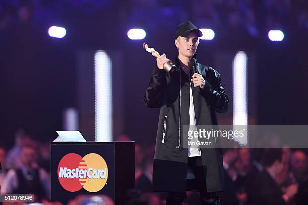 Justin Bieber onstage with his International Male Solo Artist award during the BRIT Awards 2016 at The O2 Arena on February 24 2016 in London England