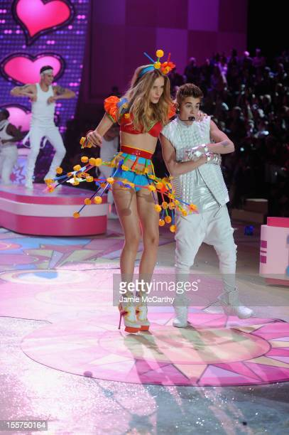 Justin Bieber performs as model Dorothea Barth Jorgensen walks the runway during the 2012 Victoria's Secret Fashion Show at the Lexington Avenue...