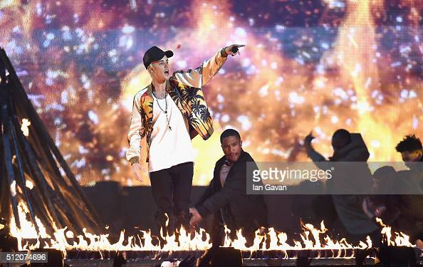 Justin Bieber performs on stage at the BRIT Awards 2016 at The O2 Arena on February 24 2016 in London England