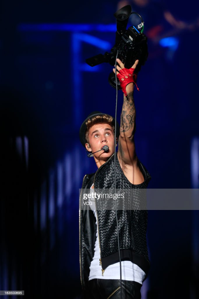 <a gi-track='captionPersonalityLinkClicked' href=/galleries/search?phrase=Justin+Bieber&family=editorial&specificpeople=5780923 ng-click='$event.stopPropagation()'>Justin Bieber</a> performs on the stage in concert at Mercedes-Benz Arena on October 5, 2013 in Shanghai, China.
