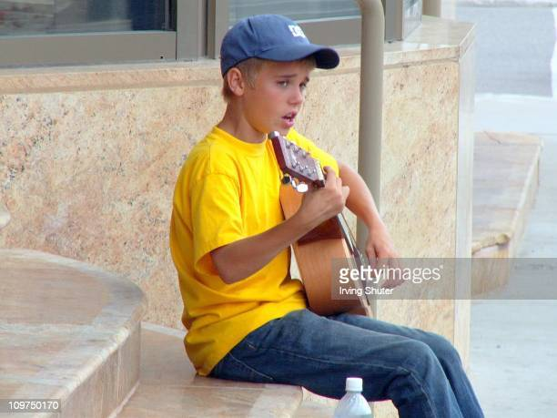 Justin Bieber performs on the street August 20 2007 in Stratford Canada