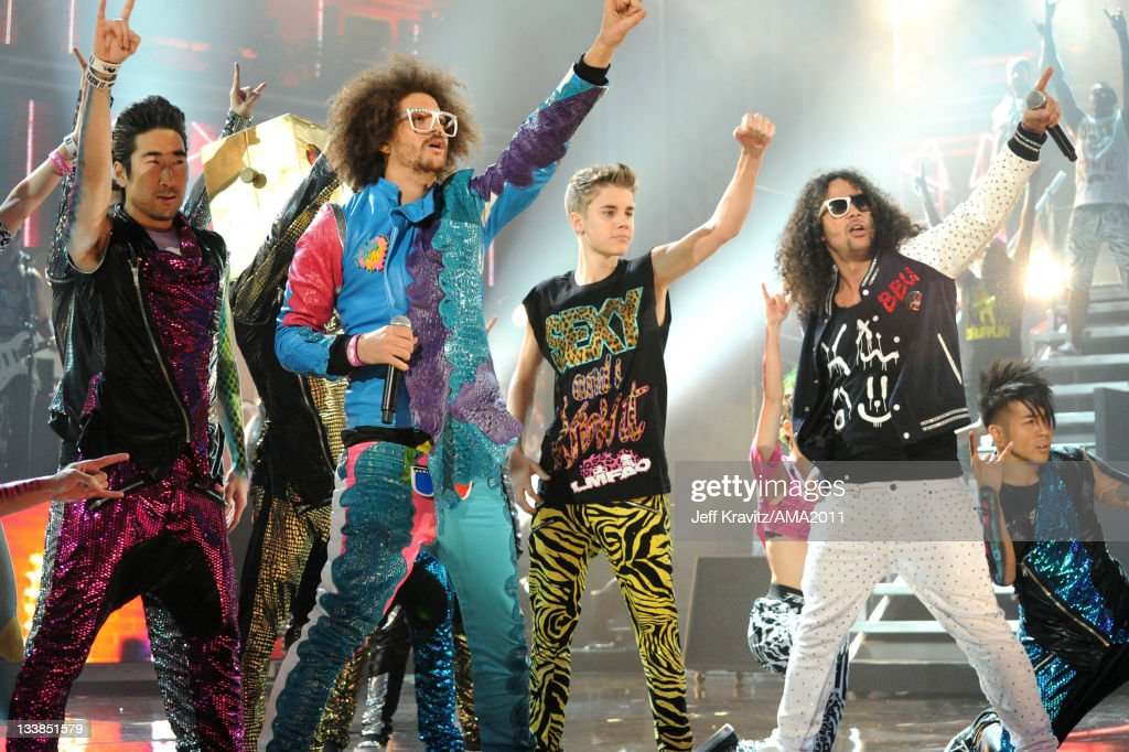 Justin Bieber performs with LMFAO onstage at the Nokia Theatre LA LIVE on November 20 2011 in Los Angeles California