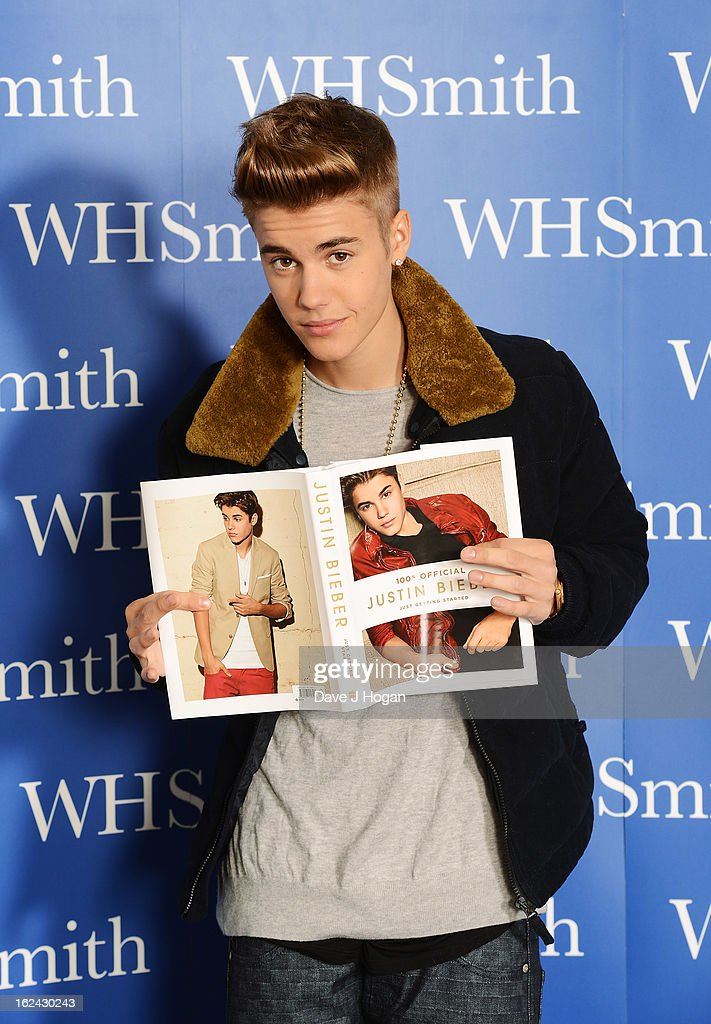 Justin Bieber poses with a copy of his new book during his 'Just Getting Started' book launch at the Congress Centre on February 23, 2013 in London, United Kingdom.