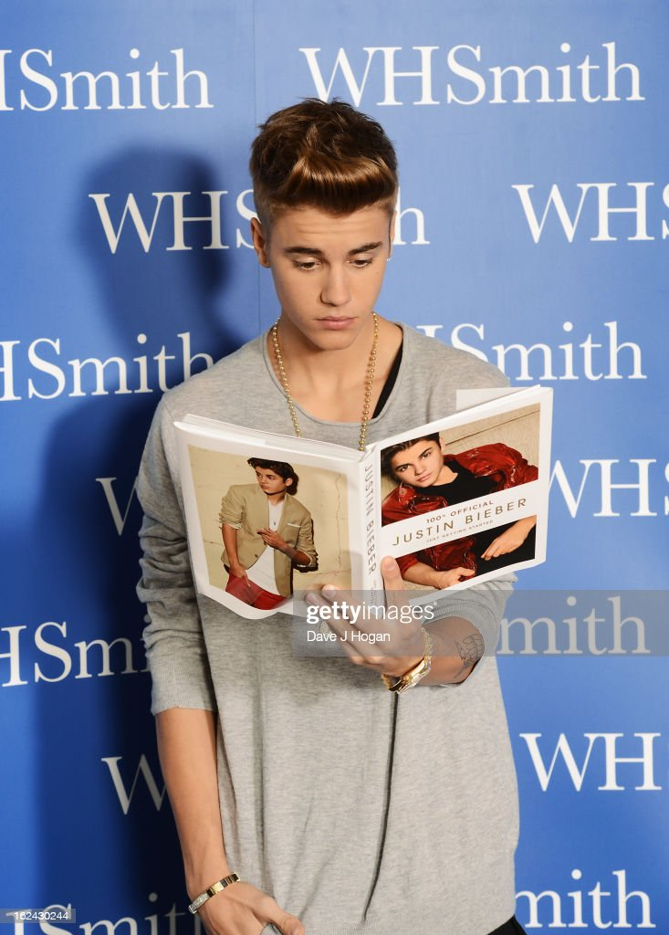 <a gi-track='captionPersonalityLinkClicked' href=/galleries/search?phrase=Justin+Bieber&family=editorial&specificpeople=5780923 ng-click='$event.stopPropagation()'>Justin Bieber</a> poses with a copy of his new book during his 'Just Getting Started' book launch at the Congress Centre on February 23, 2013 in London, United Kingdom.