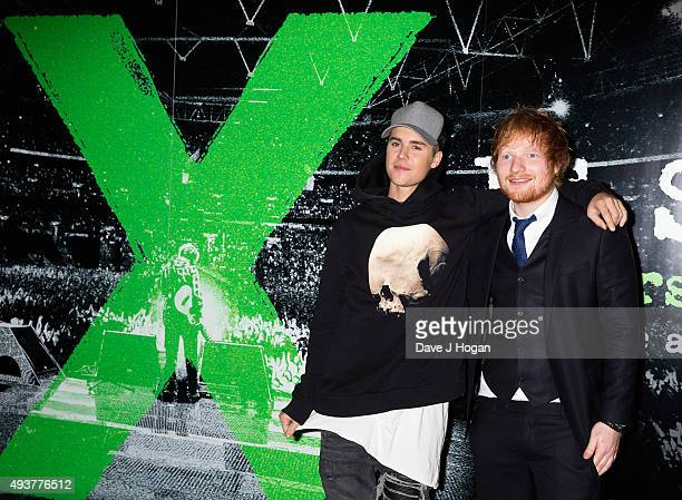 Justin Bieber poses with Ed Sheeran at the World Premiere of 'Jumpers For Goalposts' at Odeon Leicester Square on October 22 2015 in London England