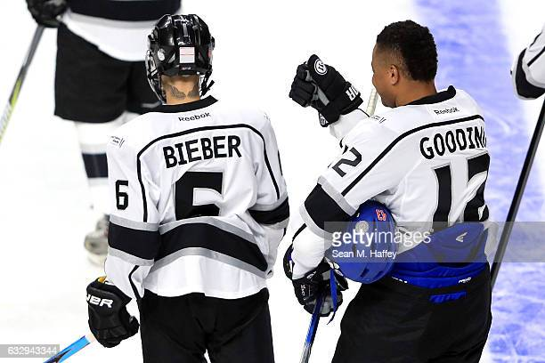 Justin Bieber stands alongside Cuba Gooding Jr during the 2017 NHL AllStar Celebrity Shootout as part of the 2017 NHL AllStar Weekend at STAPLES...