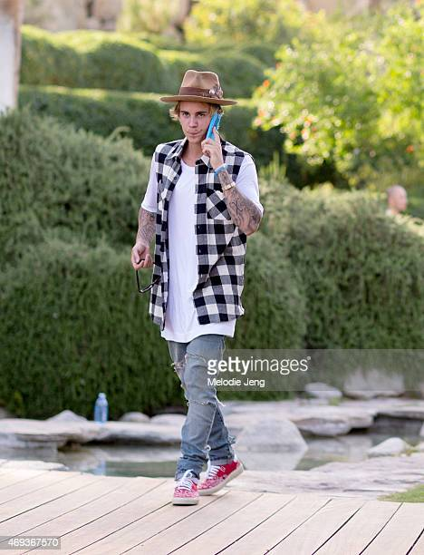 Justin Bieber wearing a Nick Fouquet hat attends the Views from The One party at The dFm House during the 2015 Coachella Valley Music And Arts...