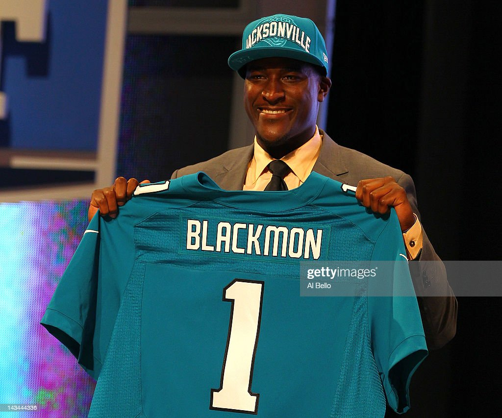 <a gi-track='captionPersonalityLinkClicked' href=/galleries/search?phrase=Justin+Blackmon&family=editorial&specificpeople=6236641 ng-click='$event.stopPropagation()'>Justin Blackmon</a> from Oklahoma State holds up a jersey as he stands on stage after he was selected #5 overall by the Jacksonville Jaguars in the first round of the 2012 NFL Draft at Radio City Music Hall on April 26, 2012 in New York City.