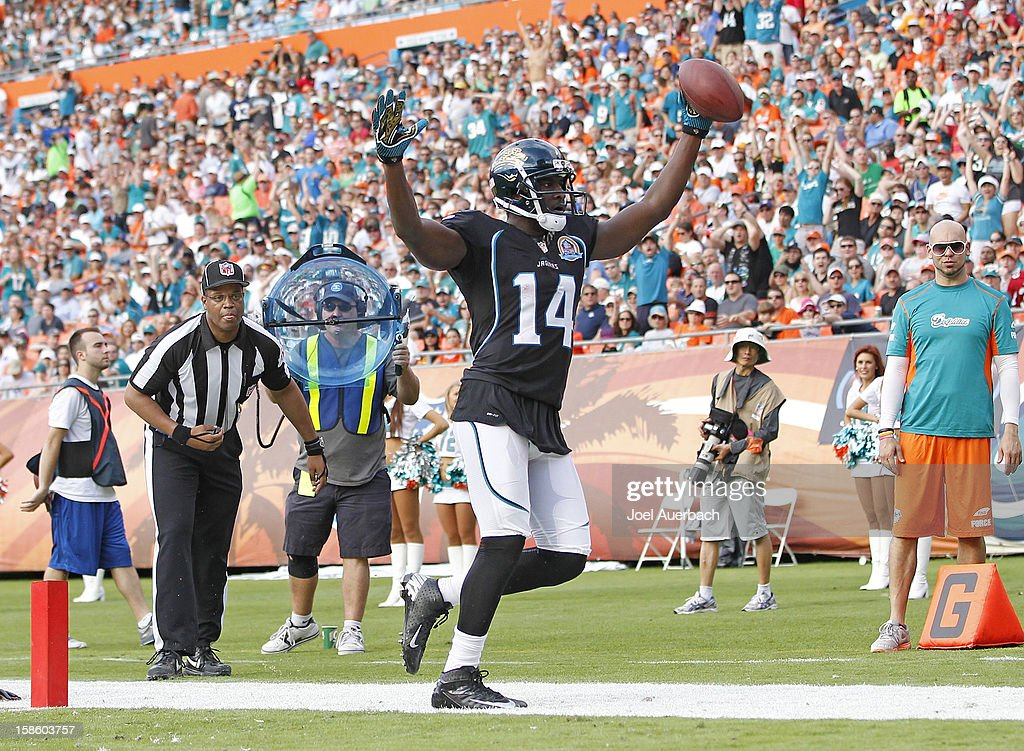 <a gi-track='captionPersonalityLinkClicked' href=/galleries/search?phrase=Justin+Blackmon&family=editorial&specificpeople=6236641 ng-click='$event.stopPropagation()'>Justin Blackmon</a> #14 of the Jacksonville Jaguars celebrates what he believes is a touchdown against the Miami Dolphins on December 16, 2012 at Sun Life Stadium in Miami Gardens, Florida. The play was called out of bounds. The Dolphins defeated the Jaguars 24-3.