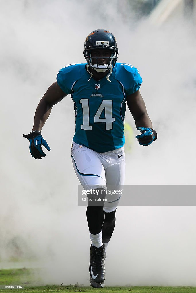 <a gi-track='captionPersonalityLinkClicked' href=/galleries/search?phrase=Justin+Blackmon&family=editorial&specificpeople=6236641 ng-click='$event.stopPropagation()'>Justin Blackmon</a> #14 of the Jacksonville Jaguars enters the field prior to a game against the Cincinnati Bengals at EverBank Field on September 30, 2012 in Jacksonville, Florida.