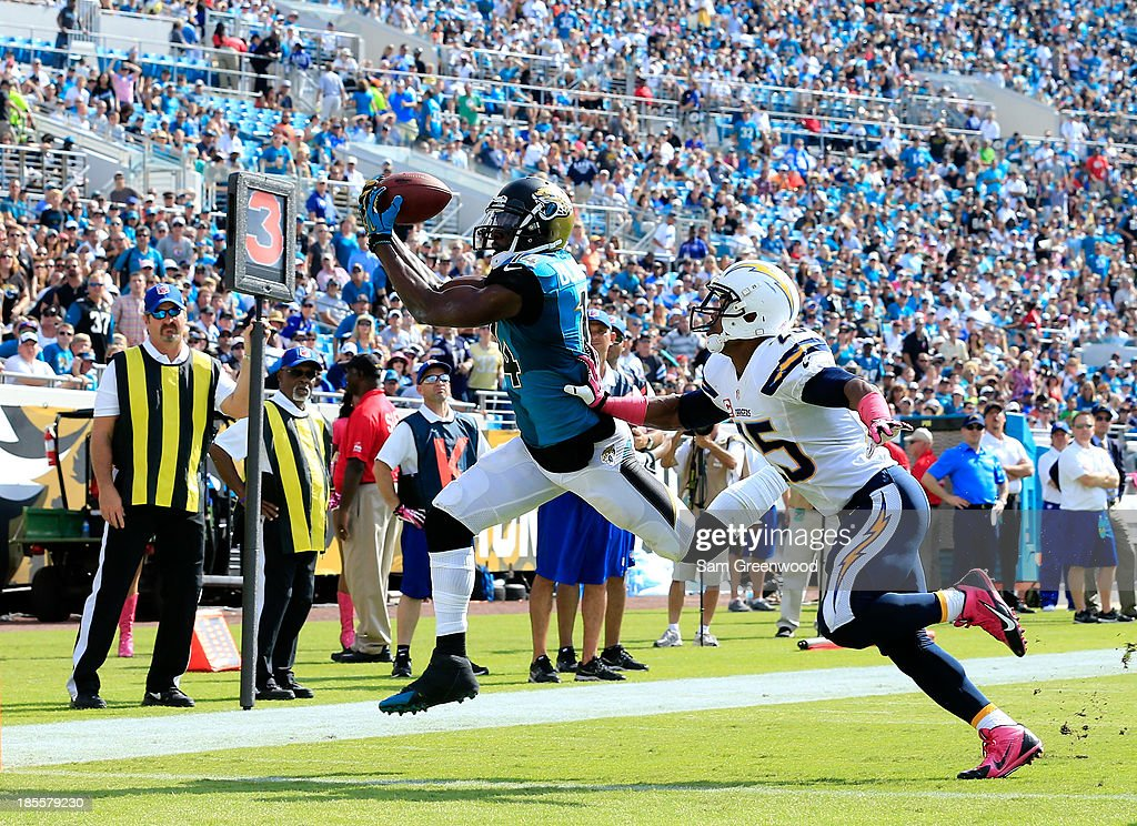 <a gi-track='captionPersonalityLinkClicked' href=/galleries/search?phrase=Justin+Blackmon&family=editorial&specificpeople=6236641 ng-click='$event.stopPropagation()'>Justin Blackmon</a> #14 of the Jacksonville Jaguars makes a reception against <a gi-track='captionPersonalityLinkClicked' href=/galleries/search?phrase=Darrell+Stuckey&family=editorial&specificpeople=4607733 ng-click='$event.stopPropagation()'>Darrell Stuckey</a> #25 of the San Diego Chargers during the game at EverBank Field on October 20, 2013 in Jacksonville, Florida.