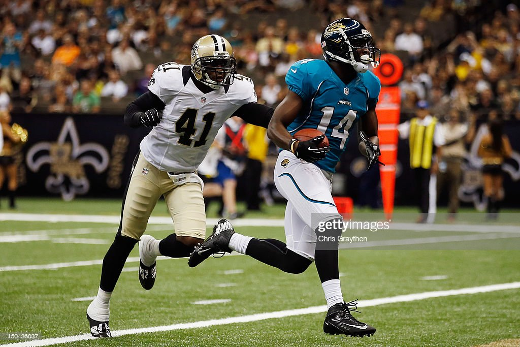 Justin Blackmon of the Jacksonville Jaguars scores a touchdown over Roman Harper of the New Orleans Saints at the MercedesBenz Superdome on August 17...