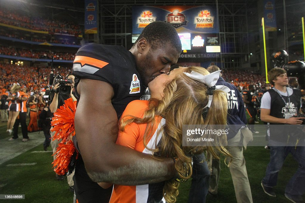 Justin Blackmon #81 of the Oklahoma State Cowboys celebrates with a cheerleader after Oklahoma State Cowboys won 41-38 in overtime against the Stanford Cardinal during the Tostitos Fiesta Bowl on January 2, 2012 at University of Phoenix Stadium in Glendale, Arizona.