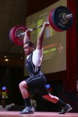 Justin Blake Spencer of Canada B competes in Men's 94kg Clean and Jerk during day six of the 2013 Junior Weightlifting World Championship at Maria...