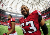 Justin Blalock and Cliff Matthews of the Atlanta Falcons head off the field after the game against the St Louis Rams at the Georgia Dome on September...