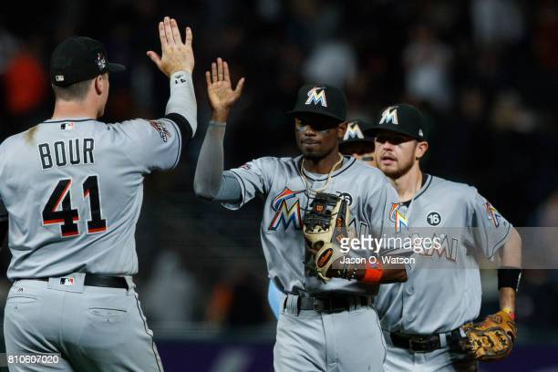Justin Bour of the Miami Marlins and Dee Gordon celebrate after the game against the San Francisco Giants at ATT Park on July 7 2017 in San Francisco...