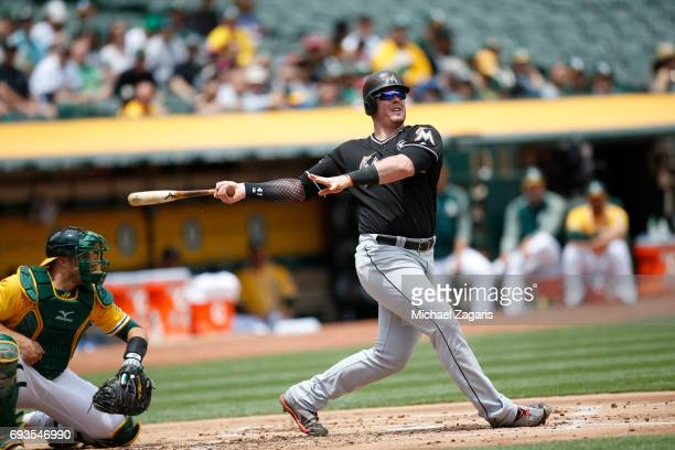 Justin Bour of the Miami Marlins bats during the game against the Oakland Athletics at the Oakland Alameda Coliseum on May 24 2017 in Oakland...