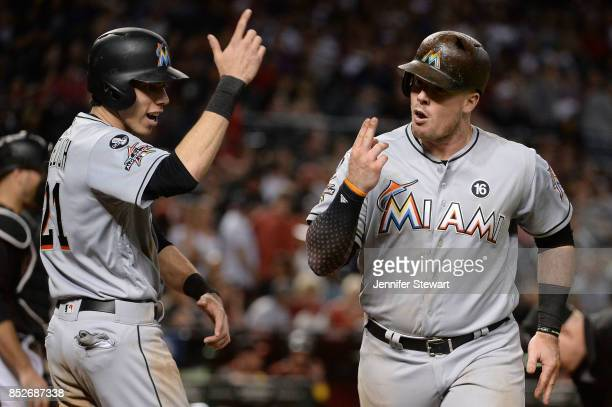 Justin Bour of the Miami Marlins celebrates with Christian Yelich after hitting a two run home run in the eighth inning of the MLB game against the...