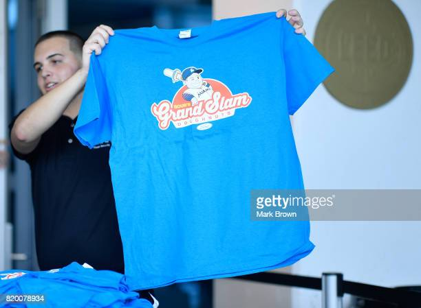 Justin Bour of the Miami Marlins Grand Slam Doughnuts Tshirts before the game between the Miami Marlins and the Los Angeles Dodgers at Marlins Park...