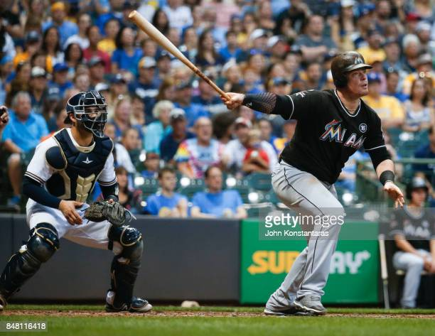 Justin Bour of the Miami Marlins hits a double during the third inning of their game against the Milwaukee Brewers at Miller Park on September 16...